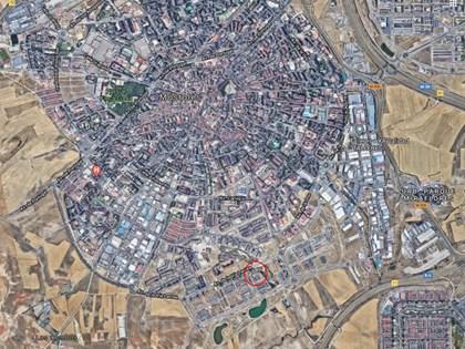 S33.2 — Cuota indivisa (12,60%) de parcela finalista en el PAU4 de Mostoles, Madrid.