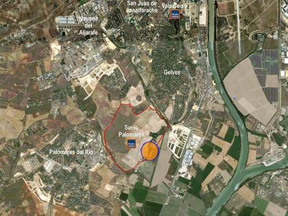 S54.2 — Cuota indivisa (50%) de finca de suelo no urbanizable en Palomares del Río, Sevilla.